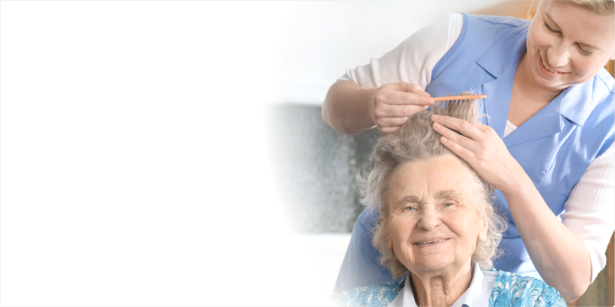 Caregiver brush the hair of the old woman